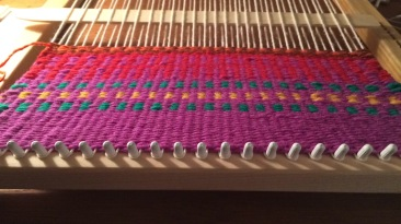 "My mother went to school for fiber arts, so I cornered her to teach me how to weave on a lap loom! Someday I'll ""graduate"" to her table and floor looms packed away in the basement..."